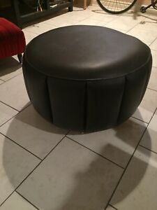 Black feux leather ottoman on wheels