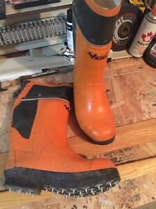 Viking chainsaw safety boots with spikes