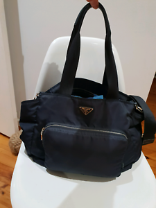 3b3d919da670 ... official store near new conditionbr authentic prada baby bag in navy  blue with gold zipbr plenty