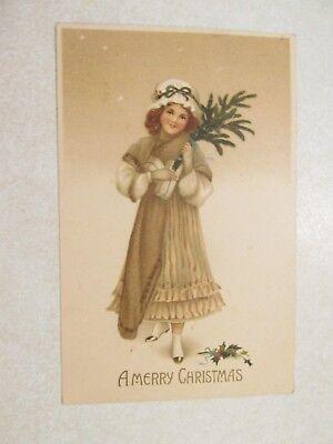E169 Postcard Merry Christmas girl holding blanket and tree Shirland IL Jewett ()