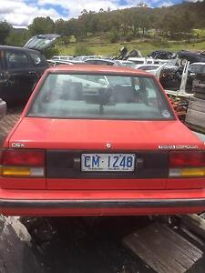 Now wrecking:  1988 Toyota Corolla AE82 Sedan Red Manual Huonville Huon Valley Preview