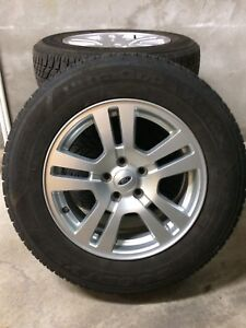 4 pneus d hiver goodyear sur mags Ford