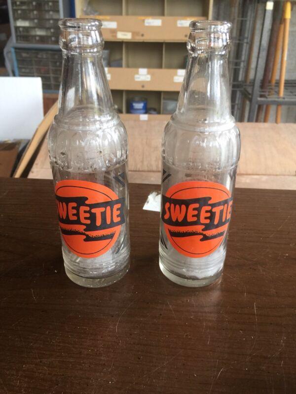 Nice Pair Of ACL SWEETIE Soda Bottles