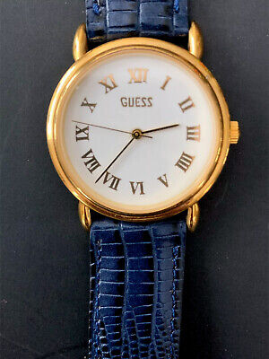 Guess Watch Gold Tone Rim Roman Numerals With Blue Leather Band