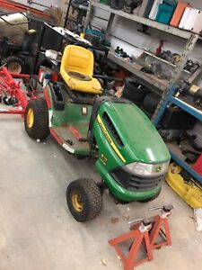 John deere with plow and deck