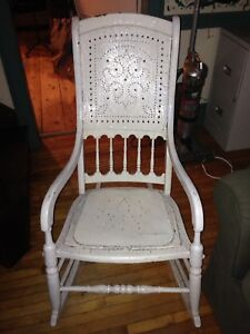 Antique high back rocking chair