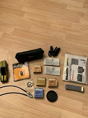 Nikon Assorted Camera Accessories Shutter Eyepiece Battery Owners Manual Filters