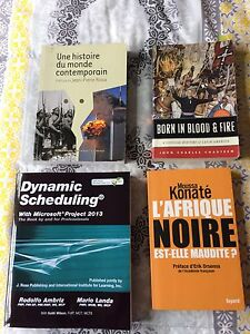 Assorted books in French and English for sale.