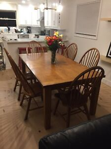 Large solid oak dining table with 6 chairs