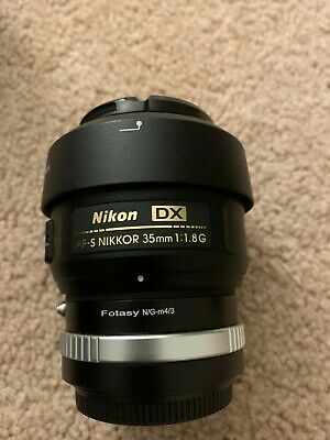 Nikon Nikkor AF-S DX 35 mm F/1.8G Lens w/ heliopan UV Haze filter