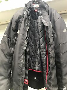 Rocket dry tech motorcycle coat and pants . See photos