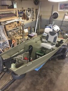 12 foot Tracker with 10 hp Honda motor and Trailer.