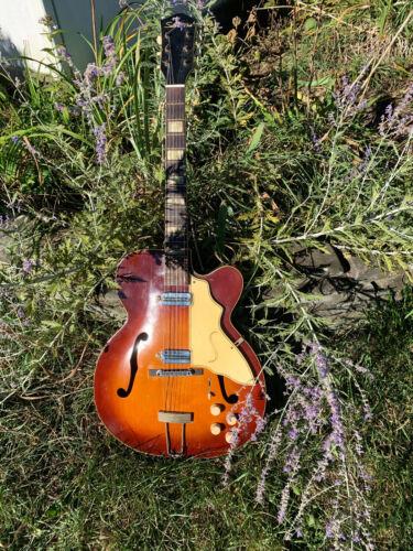 Vintage Silvertone Aristocrat archtop electric guitar.