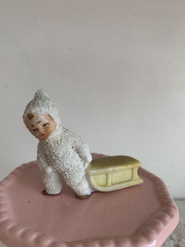 Vintage German Bisque Snowbaby Pulling Sled Figurine