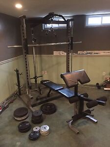 Smith machine with weights and bars