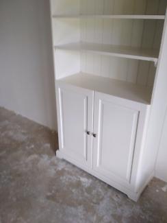 white cabinet and book shelf