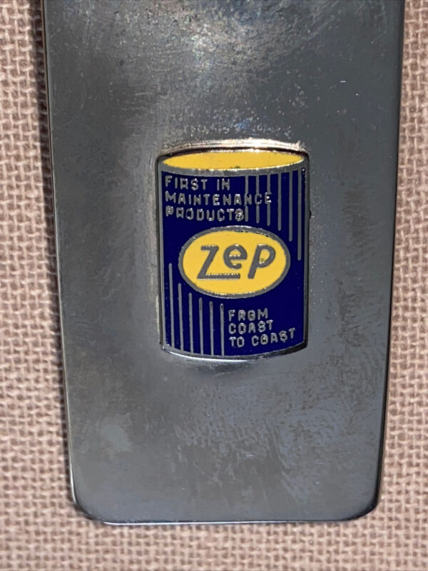 vintage,  Zep money clip, Stainless and a raised enameled Logo