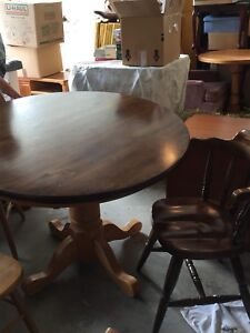 Solid round dark brown kitchen table with chairs