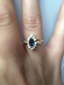 Never worn blue sapphire 14k ring with clear real diamonds 6.5-7