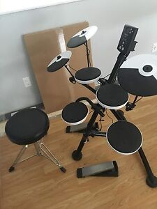 Brand new Roland TD-1K Electric drums with throne.