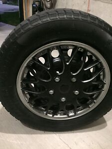 4 winter tires w rims and hubcaps.