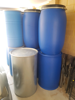 Various plastic and steel drums