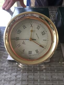 Near new brass clock and barometer