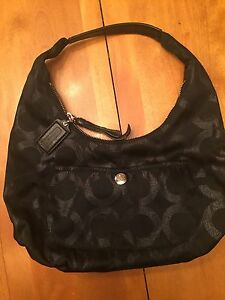 Brand new, authentic Coach purse (never used)