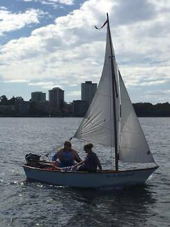 IN A NUTSHELL Sailing Boat with 3.3 Mer outboard mt and Trailer.