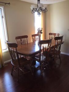 Table, chairs, and hutch