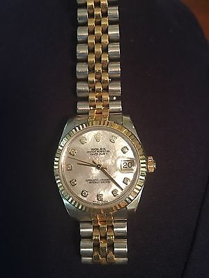 Never worn oyster and diamond ladies Rolex wristwatch, traditional band.