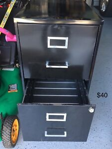 Metal file cabinet,office chairs,indoor Moving garage sale
