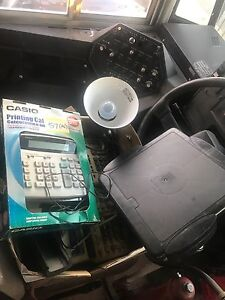 Office box with printing calculators, desk lamp and more