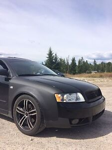 *looking* Audi A4 aftermarket exhaust