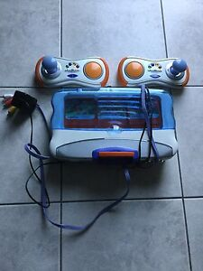V-tech set, 5 games and 2 controllers