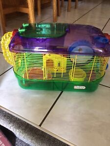 Hamster cage and accessories! Also a bag of shaving!