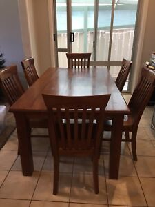 Solid timber dining table with 6 chairs