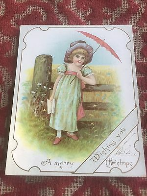 1880s christmas card ! pretty young girl by a gate !