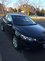 2012 Kia Forte EX with alloy rims and extra snow tires