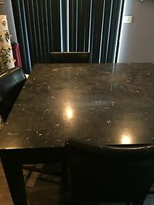 Black wooden marble top dinette with 6 chairs