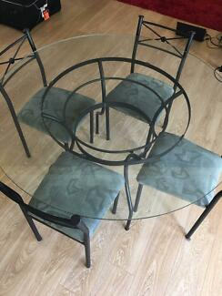 Glass Dining Table with 4 Dining Chairs in great condition