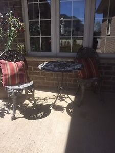 Iron chairs and table outside
