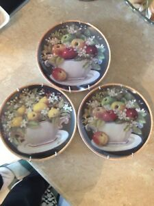 3 beautiful fruit decor plates with hangers.