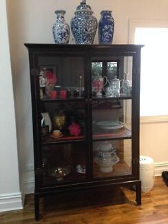 Elegant black wood and glass cabinet