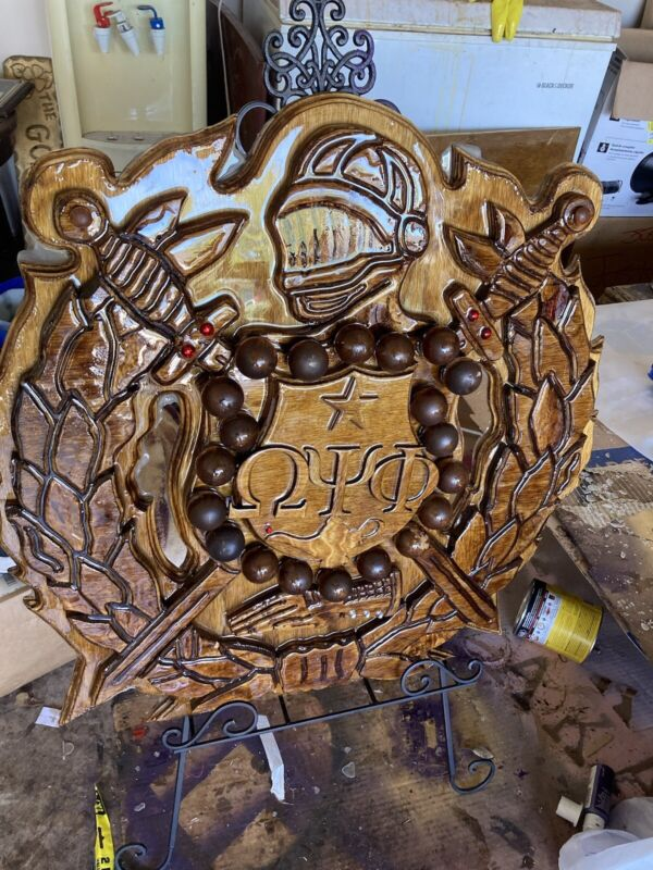 Woodwn Omega Psi Phi Shield.