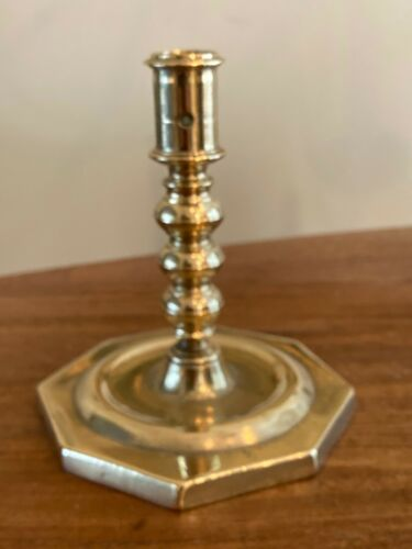 SPANISH BRASS OCTAGONAL BASE CANDLESTICK WITH SHAFT SCREWED TO BASE, 1690-1710