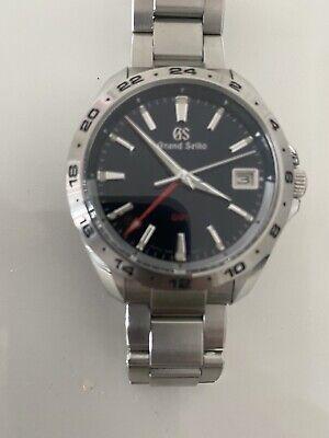 Grand Seiko GMT quartz watch SBGN005 blue dial: boutique warranty.