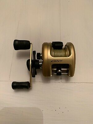 BNT2239 Calyx CYX100 NEW SHIMANO BAITCASTING REEL PART Right Side Plate