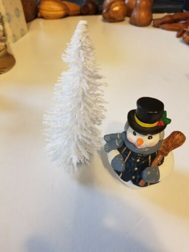 SNOWMAN FIGURINE AND FLOCKED WHITE TREE LOT