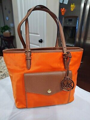 Michael kors medium orange nylon jet set tote handbag in excellent condition